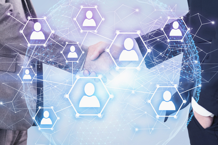 Two businessmen shaking hands over white background with planet interface and social media icons. Concept of partnership. Toned image double exposure