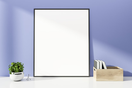 Mock up poster frame standing on white table in room with purple walls and box with books. Concept of advertising. 3d rendering Zdjęcie Seryjne