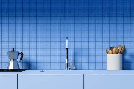 Close up of kitchen counter with built in sink and stove and jar with wooden spoons standing in room with blue tile walls. 3d rendering