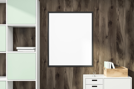 Mock up poster with black frame hanging on wooden wall in room with white cabinet and light blue bookcase. 3d rendering