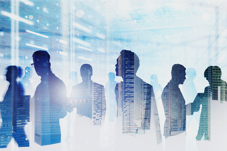 Diverse team of computer engineers in server room interior double exposure of cityscape and network hologram. Concept of big data and cloud computing. Toned image blur