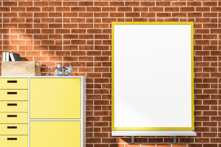 Mock up poster with yellow frame standing on shelf in room with brick walls and wooden bookcase. Concept of advertising. 3d rendering