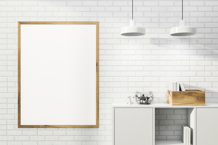 Blank mock up poster with wooden frame hanging on white brick wall in room with white bookcase and stylish ceiling lamps. Concept of advertising. 3d rendering