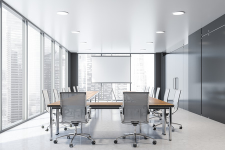 Interior of panoramic meeting room with black walls, concrete floor, wooden table with metal chairs and mock up projection screen. 3d rendering Imagens