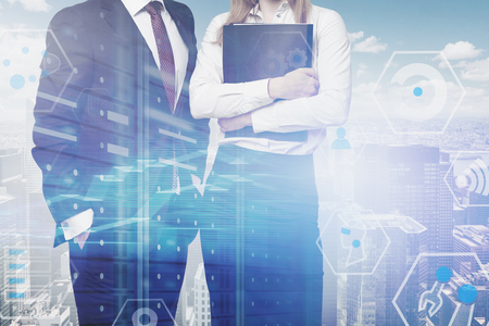 Man in suit and businesswoman with folder over cityscape background with double exposure of digital business interface. Concept of telecommunication, IoT, big data and coding. Toned image