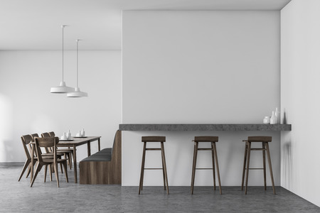 Interior of white cafe with concrete floor, dark wooden tables with chairs and gray sofa and industrial style lamps. Bar counter with stools. 3d rendering Imagens