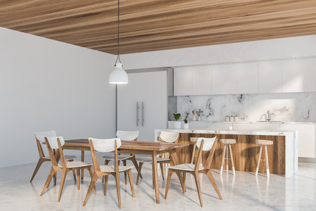 Luxury kitchen corner with white and marble walls, concrete floor, white countertops and bar with stools and wooden dining table with chairs. 3d rendering