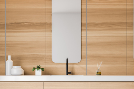 Interior of modern bathroom with wooden walls and sink standing on wooden counter with mirror above it. 3d rendering