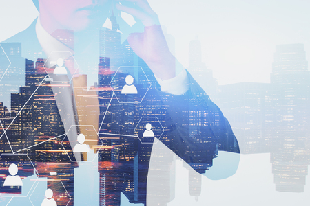 Unrecognizable man in suit talking on smartphone in city with double exposure of city panorama and social network icons. Concept of social connection in business and HR. 3d rendering toned image