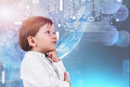 Adorable little boy in white shirt thinking standing over planet Earth hologram with circuit interface. Concept of Internet and modern technology. Toned image. Elements of this image furnished by NASA