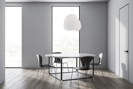 Loft dining room interior with white walls, wooden floor, round table with black chairs and windows with tropical view. 3d rendering