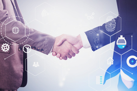 Two unrecognizable businessmen shaking hands over gray background with double exposure of digital business interface. Concept of hi tech and AI. Toned image Imagens - 124676601