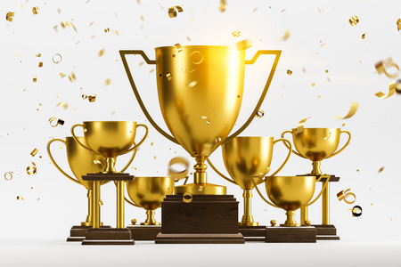Gold champion trophies on dark wooden stands with confetti standing on white surface over white background. Concept of leadership in business and sport. 3d rendering toned image Stock Photo