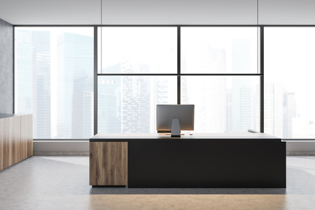 Interior of CEO office with concrete walls and floor, gray and wooden computer table and panoramic window with cityscape. 3d rendering Imagens