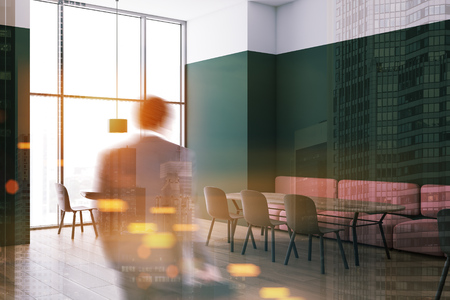 African American man in suit entering modern cafe with white and green walls, pink sofas and gray chairs near wooden tables. Toned image double exposure blurred Stok Fotoğraf