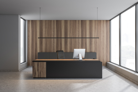 Interior of CEO office with white and wooden walls, concrete floor, black and wooden computer table and gray cabinet. 3d rendering Imagens