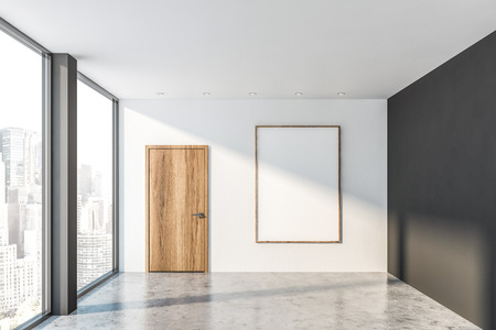 Interior of empty office with gray and white walls, concrete floor, large window with cityscape, wooden door and vertical mock up poster frame. Concept of advertising. 3d rendering Stock Photo