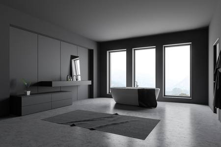 Corner of loft bathroom with dark gray walls, concrete floor, white bathtub standing near three windows and gray sink with mirror. 3d rendering