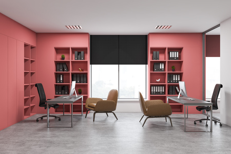 Interior of open space office with white and pink walls, concrete floor, gray computer tables with armchairs for visitors and pink bookcases with folders. 3d rendering Imagens