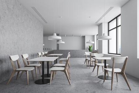 Modern industrial style bar interior with white and concrete walls, concrete floor, bar counter with stools and square white tables with chairs. 3d rendering Reklamní fotografie