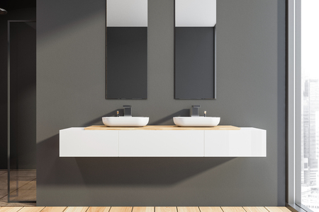 Interior of panoramic bathroom with dark gray walls, wooden floor, two sinks standing on white countertop with vertical mirrors above it and shower stall with glass door. 3d rendering Stok Fotoğraf - 124702671