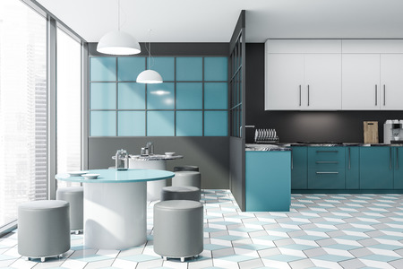 Interior of stylish kitchen with gray and blue walls, tiled floor, blue countertops and white cupboards and two round tables with chairs. 3d rendering Stock Photo