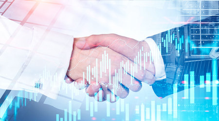 Close up of two businessmen shaking hands over cityscape background with double exposure of forex graphs. Concept of partnership and stock market. Toned image blurred Imagens