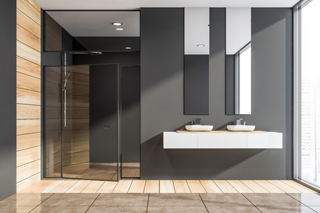 Interior of modern bathroom with dark gray and wooden walls, wooden and tiled floor, double sink on white countertop and shower stall with glass doors. 3d rendering