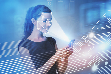 Smiling young woman with smartphone. Face recognition and biometric verification interface. Concept of cyber security and AI. Toned image double exposure blurred