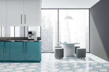 Interior of panoramic kitchen with gray walls, tiled floor, blue countertops with coffee machine, white cupboards and round table with chairs. 3d rendering