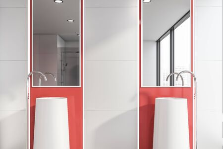 Close up of stylish double bathroom sink with vertical mirrors above it standing in modern bathroom interior with white tile and red walls. 3d rendering
