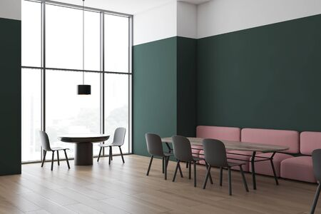 Corner of modern restaurant with green and white walls, wooden floor, pink sofas and gray chairs standing near round and wooden tables and big window. 3d rendering
