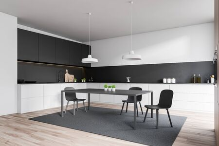 Corner of stylish kitchen with white and black walls, wooden floor, white countertops, gray cupboards and dining table standing on carpet. 3d rendering