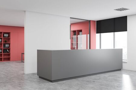 Interior of modern office with white walls, concrete floor, gray reception desk and pink bookcases with folders in background. 3d rendering Banco de Imagens