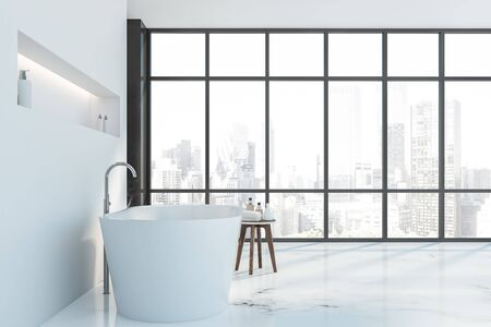 Side view of luxury bathroom with black marble and white walls, white marble floor, white bathtub with shelf above it and chair with towels and shampoos. Panoramic window with cityscape. 3d rendering Banco de Imagens