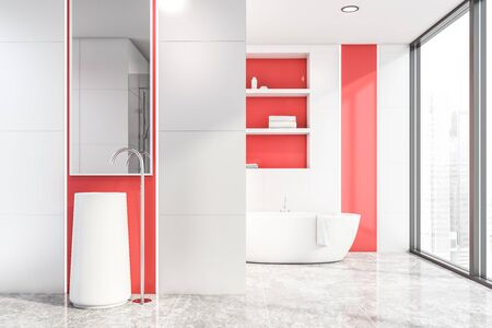 Interior of modern bathroom with white tile and red walls, concrete floor, white freestanding sink with mirror above it and bathtub with shelves in background. 3d rendering Banco de Imagens