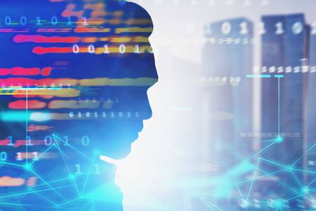 Silhouette of man head in blurred city with double exposure of network hologram and lines of code. Artificial intelligence and smart city concept. Toned image