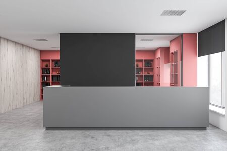 Interior of modern office with black and wooden walls, concrete floor, gray reception desk and pink bookcases with folders in background. 3d rendering