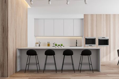 Interior of modern kitchen with white and wooden walls, wooden floor, white countertops and cupboards and white bar with stools. 3d rendering Standard-Bild - 124973178