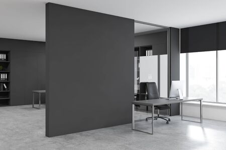 Corner of CEO office with gray walls, concrete floor, gray computer table near panoramic window and blank gray mock up wall. 3d rendering Banco de Imagens