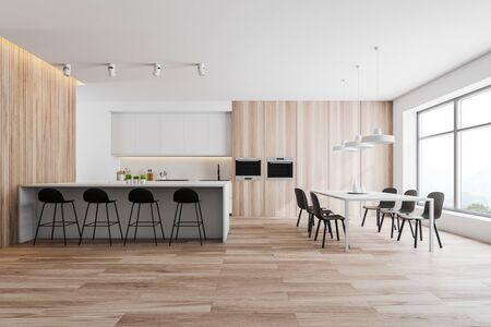 Interior of modern kitchen with white and wooden walls, wooden floor, white countertops and cupboards, dining table with black chairs and white bar with stools. 3d rendering