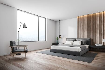 Corner of minimalistic bedroom with white and wooden walls, wooden floor, gray master bed with black bedside tables and gray carpet. Comfortable armchair with floor lamp. 3d rendering