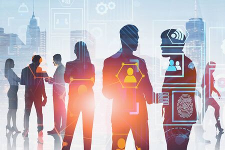 Silhouettes of business people over cityscape background with double exposure of social network and business interface. Concept of hi tech and communication. Toned image