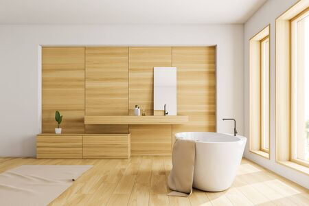 Side view of loft bathroom with white and wooden walls, wooden floor, white bathtub standing near two windows and wooden sink with mirror. 3d rendering Banco de Imagens