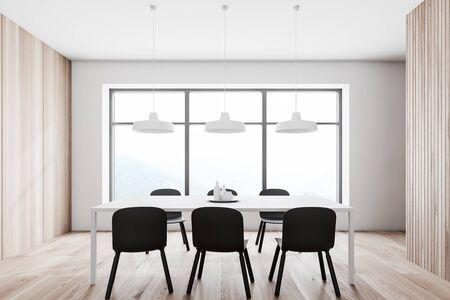 Interior of minimalistic dining room with white and wooden walls, wooden floor, white table with black chairs and large window. 3d rendering