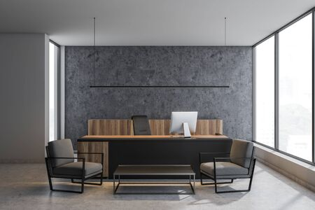 Interior of CEO office with concrete and white walls, black and wooden table with computer and coffee table with gray armchairs. 3d rendering