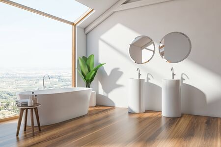 Corner of loft Scandinavian style bathroom with white walls, wooden floor, white bathtub standing near window and double sink with round mirrors. 3d rendering Banco de Imagens