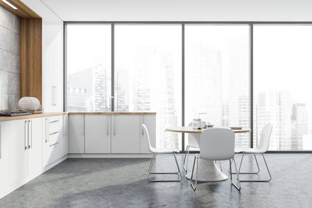 Interior of panoramic kitchen with concrete walls and floor, white countertops with built in sink and cooker and round table with chairs. 3d rendering Reklamní fotografie