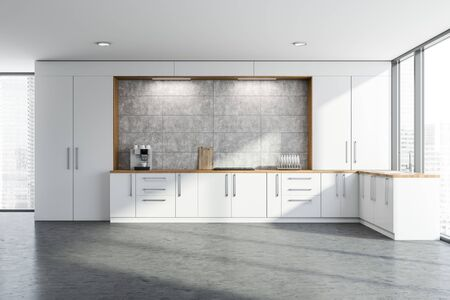 Interior of panoramic kitchen with concrete walls and floor and white countertops with built in cooker and sink. 3d rendering Imagens