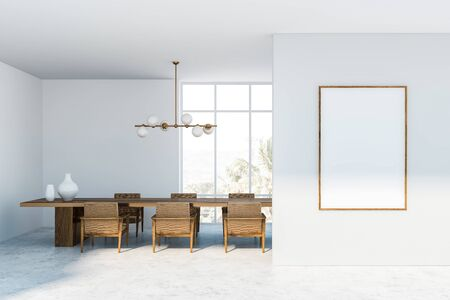 Interior of panoramic dining room with white walls, concrete floor, dark wooden table with armchairs and stylish lamp. Mock up poster on the right. 3d rendering 版權商用圖片